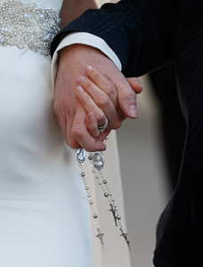 "A newly married couple hold rosaries in their hands as they leave Pope Francis' general audience in St. Peter's Square at the Vatican Feb. 24. Pope Francis' postsynodal apostolic exhortation on the family, ""Amoris Laetitia"" (""The Joy of Love""), was to be released April 8. The exhortation is the concluding document of the 2014 and 2015 synods of bishops on the family. (CNS photo/Paul Haring)"