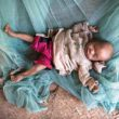 An eight-month-old baby lies on the floor at home in Amboasary, Madagascar, Sept. 21, 2015. Hunger levels are now so severe in drought-ridden southern Madagascar that many people in remote villages have eaten almost nothing but cactus fruit for up to four years, said a Catholic Relief Services official. (CNS photo/Shiraaz Mohamed, EPA)